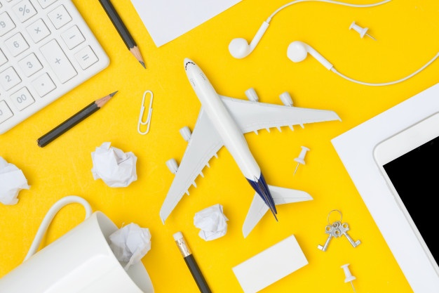 flat-lay-travel-planning-with-blank-space-yellow-background_41775-490