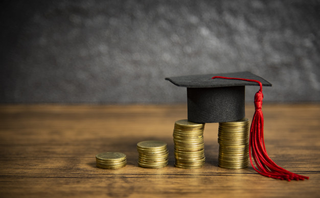 scholarships-education-concept-with-graduation-cap-coin-money-saving-grants-education_73523-588